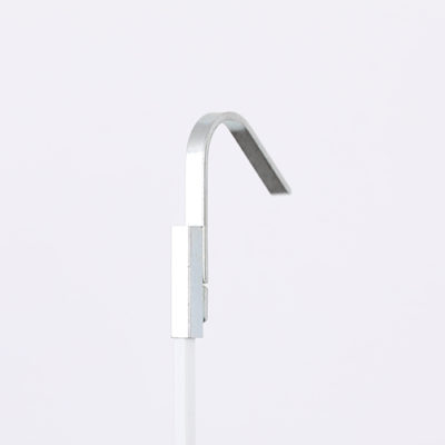 A picture rail hook or rod sleeve in silver.
